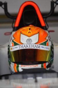 ben in his cockpit, his helmet shows off his sponsor thakeham