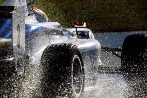 ben pulls away in his car in wet conditions