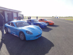 3 track cars from left to right